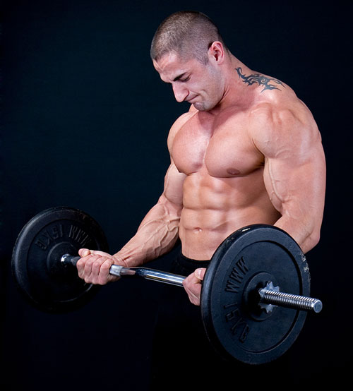Many trainers advise using a curved barbell bar. It is believed that this projectile is more convenient when pumping biceps.